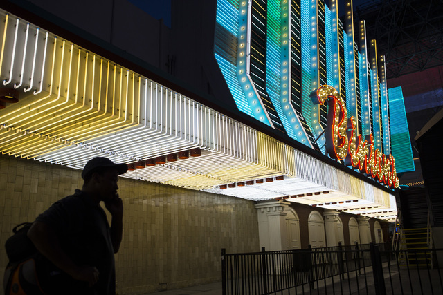 A man walks by the exterior of Binion's hotel-casino at Fremont Street Experience in downtown Las Vegas on Wednesday, Aug. 10, 2016. Chase Stevens/Las Vegas Review-Journal Follow @csstevensphoto