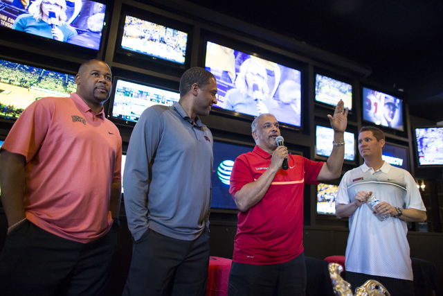 UNLV basketball head coach Marvin Menzies, third from left, talks alongside assistant coaches, from left, Andre Lafleur, Rob Jeter and Eric Brown during a meet and greet at Born and Raised in Las  ...