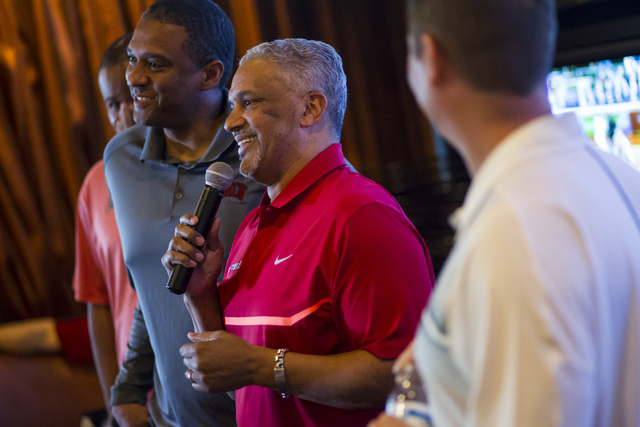 UNLV basketball head coach Marvin Menzies, center, speaks during a meet and greet at Born and Raised in Las Vegas on Tuesday, May 17, 2016. UNLV assistant basketball coaches Rob Jeter, left, and E ...