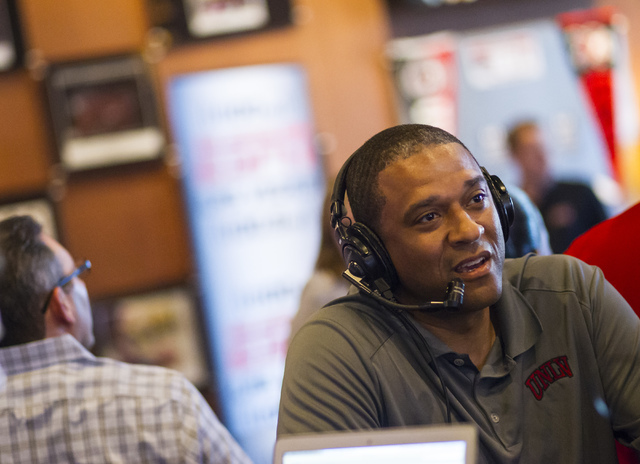 UNLV basketball assistant coach Rob Jeter speaks with ESPN Radio (1100 AM) before a meet and greet at Born and Raised in Las Vegas on Tuesday, May 17, 2016. (Chase Stevens/Las Vegas Review-Journal ...