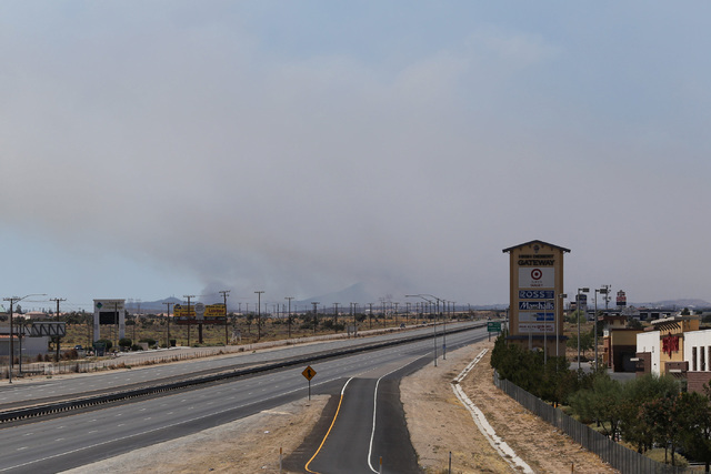 Smoke from the Blue Cut fire fills the sky above a closed I-15 in Hesperia, Calif., on Wednesday, Aug. 17, 2016. Brett Le Blanc/Las Vegas Review-Journal Follow @bleblancphoto
