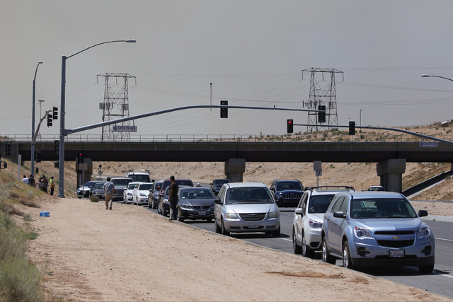People park their cars near Summit Valley Road in Hesperia, Calif., to wait for the road to reopen on Wednesday, Aug. 17, 2016. Brett Le Blanc/Las Vegas Review-Journal Follow @bleblancphoto
