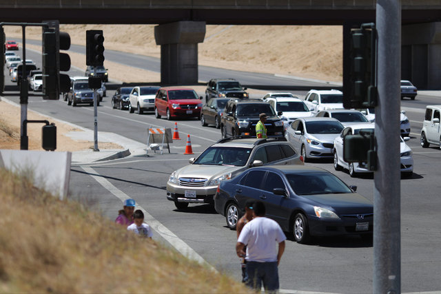 Traffic backs up as people try to take Summit Valley Road around the Blue Cut Fire in Hesperia, Calif., only to find that the road is closed on Wednesday, Aug. 17, 2016. Brett Le Blanc/Las Vegas R ...