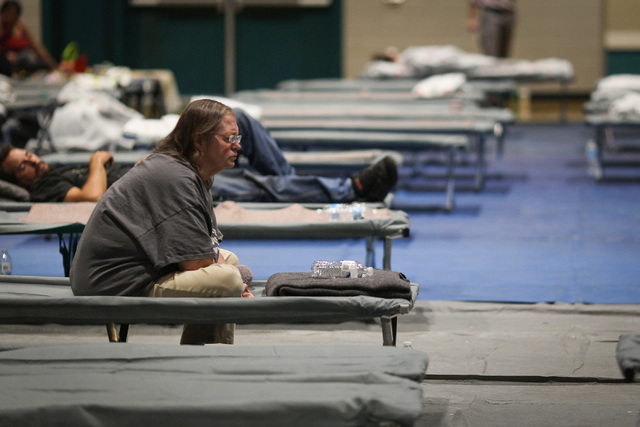An evacuee sits on a cot in the Sultana High School gym in Hesperia, Calif.,  on Wednesday, Aug. 17, 2016 after being forced from their home because of the Blue Cut fire. Brett Le Blanc/Las Vegas  ...