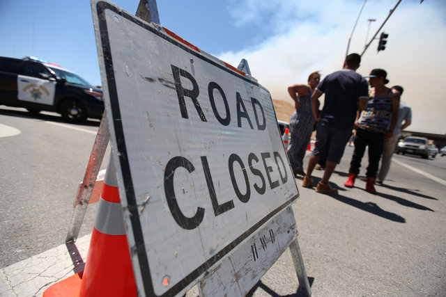 Motorists discuss a way around the Blue Cut Fire after finding Summit Valley Road in Hesperia, Calif., closed on Wednesday, Aug. 17, 2016. Brett Le Blanc/Las Vegas Review-Journal Follow @bleblancphoto