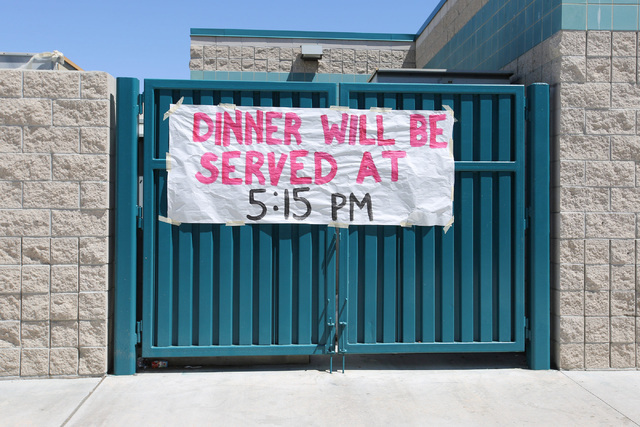 A sign advertising dinner for evacuees from the Blue Cut Fire hangs at Sultana High School in Hesperia, Calif., on Wednesday, Aug. 17, 2016. Brett Le Blanc/Las Vegas Review-Journal Follow @bleblan ...