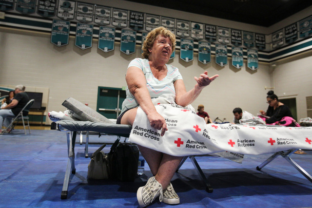 Pauline Burridge talks about being evacuated because of the Blue Cut Fire while sitting in the Sultana High School gymnasium in Hesperia, Calif., on Wednesday, Aug. 17, 2016. Brett Le Blanc/Las Ve ...