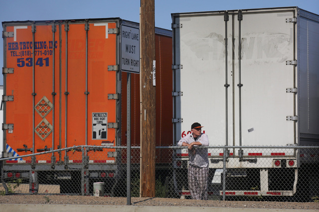 A trucker waits for I-15 through the Cajon Pass to reopen in Hesperia, Calif., on Wednesday, Aug. 17, 2016. Brett Le Blanc/Las Vegas Review-Journal Follow @bleblancphoto
