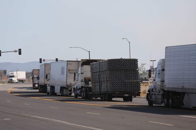 Semi trucks park on a road to wait for I-15 through the Cajon Pass to reopen in Hesperia, Calif., on Wednesday, Aug. 17, 2016. Brett Le Blanc/Las Vegas Review-Journal Follow @bleblancphoto