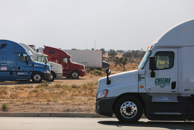 Semi trucks find parking to wait for I-15 through the Cajon Pass to reopen in Hesperia, Calif., on Wednesday, Aug. 17, 2016. Brett Le Blanc/Las Vegas Review-Journal Follow @bleblancphoto