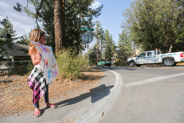Brooke Turner, 8, holds a sign thanking firefighters for battling the Blue Cut Fire in Wrightwood, Calif., on Friday, Aug. 19, 2016. Brett Le Blanc/Las Vegas Review-Journal Follow @bleblancphoto