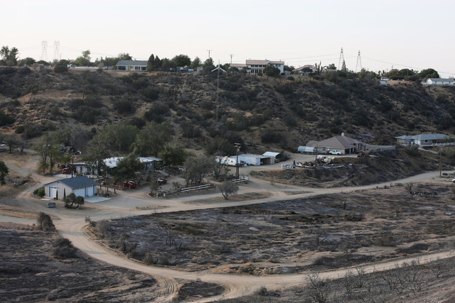 Charred earth from the Blue Cut Fire backs up to a row of houses on Friday, Aug. 19, 2016, that was saved by firefighting efforts in Hesperia, Calif. Brett Le Blanc/Las Vegas Review-Journal Follow ...