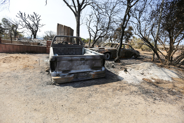 The Chavez family lost a pickup truck and a car to the Blue Cut Fire in Oak Hills, Calif., on Saturday, Aug. 20, 2016. (Brett Le Blanc/Las Vegas Review-Journal) Follow @bleblancphoto