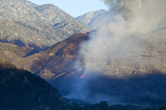 The Blue Cut Fire burns west of Interstate 15 at the Cajon Boulevard exit on Wednesday, August 17, 2016, in San Bernardino County, Calif. Northbound and southbound I-15 remains closed. Loren Towns ...