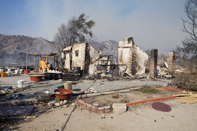 A house on Meadow Lark Lane in Phelan, Calif. is shown after the Blue Cut Fire burned through the Cajon Pass, north of San Bernardino, Calif. on Wednesday, August 17, 2016. Loren Townsley/Las Vega ...