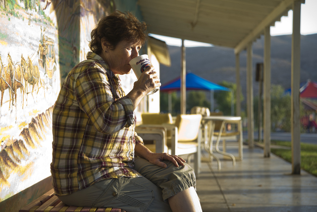 Cindy Phillips, a lon- time resident of Blue Diamond, drinks her morning coffee in front of the Village Market and Mercantile in the town of Blue Diamond on Wednesday, Aug. 10, 2016. (Daniel Clark ...
