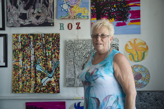 Roz Knight stands in front of a wall of her artwork at City of the World gallery. Daniel Clark/Las Vegas Review-Journal Follow @DanJClarkPhoto
