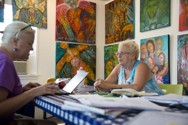 Roz Knight, right, goes over gallery paperwork with Rebecca Weeks at City of the World gallery. Daniel Clark/Las Vegas Review-Journal Follow @DanJClarkPhoto