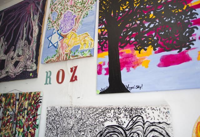 Roz Knight's artworks hang on a wall inside City of the World gallery. Daniel Clark/Las Vegas Review-Journal Follow @DanJClarkPhoto