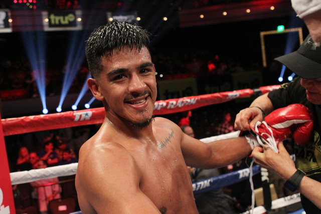 Jessie Magdaleno smiles while having his gloves removed after defeating Raul Hirales Jr. during their featherweight fight Friday, May 1, 2015, at the Cosmopolitan. Magdaleno scored a unanimous dec ...
