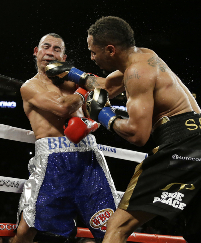 Andre Ward, right, punches Alexander Brand, of Colombia, during the 12th round of their light heavyweight boxing match Saturday, Aug. 6, 2016, in Oakland, Calif. Ward won the fight in a unanimous  ...