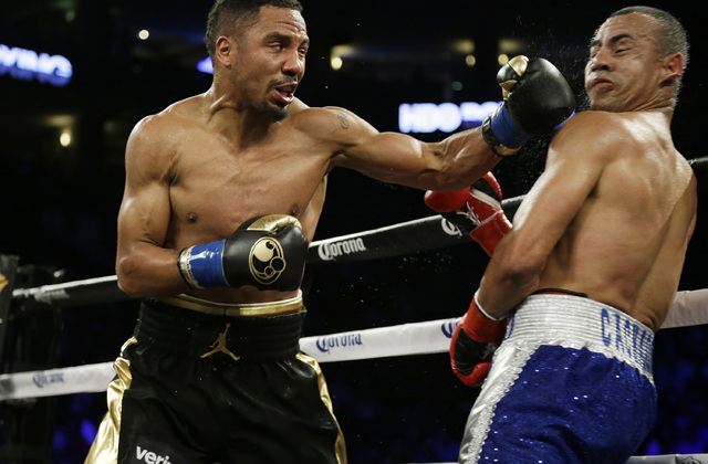 Andre Ward, left, punches Alexander Brand during the fifth round of their light heavyweight boxing match Saturday, Aug. 6, 2016, in Oakland, Calif. Ward won the fight in a unanimous decision. (AP  ...