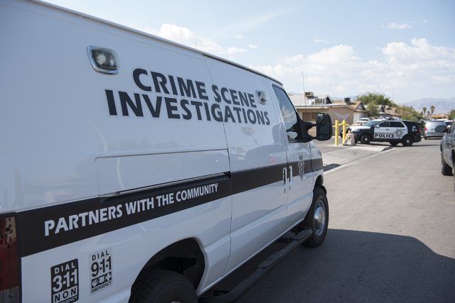 Las Vegas Metro Police Department officers investigate near the corner of Covey Lane and Irwin Avenue where a deceased body of a male in his 30s was found in North Las Vegas on Saturday, Aug. 20,  ...