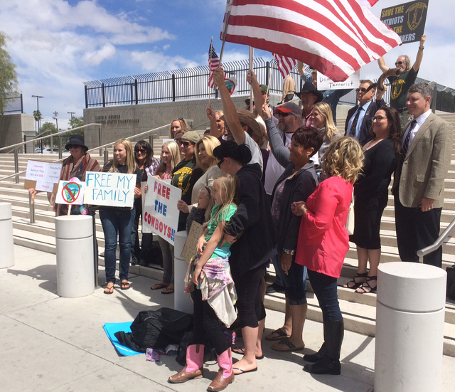 Protesters, including Assemblywoman Michele Fiore, center, pose outside the Lloyd George U.S. Courthouse ahead of an arraignment for Ammon and Ryan Bundy, among others, in Las Vegas on Friday, Apr ...