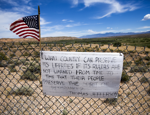 A sign posted on a fence line is seen near the Bundy Ranch near Bunkerville on Thursday, May 19, 2016. (Jeff Scheid/Las Vegas Review-Journal) Follow @jlscheid
