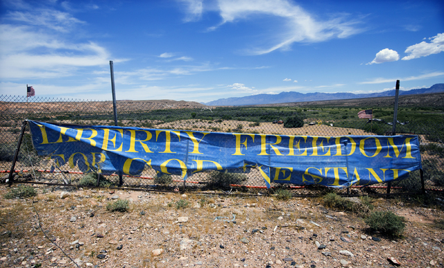A sign secured on a fence on Nevada state Route 170 near Bunkerville is seen on Thursday, May 19, 2016. (Jeff Scheid/Las Vegas Review-Journal) Follow @jlscheid