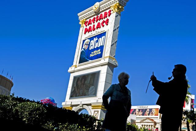 A man takes a photo across the street from Caesars Palace, 3570 South Las Vegas Boulevard, on  Wednesday, Jan.14, 2015. (Jeff Scheid/Las Vegas Review-Journal)