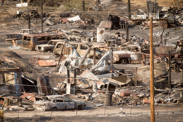 Scorched cars and trailers burned by the Blue Cut fire line a residential street in Phelan, Calif., on Friday, Aug. 19, 2016. (Noah Berger/The Associated Press)