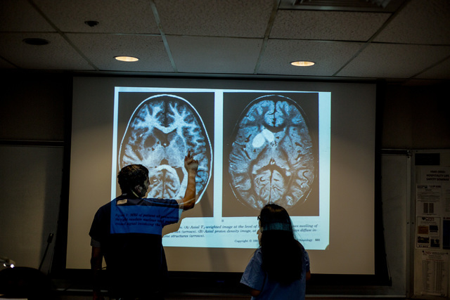 Dr. Kalyan Tatiney, left, points at different parts of a brain to CampMed participant Khaya Mae Tawatao at UNLV in Frank and Estella Beam Hall in Las Vegas apart of CampMed, Friday, July 22, 2016. ...