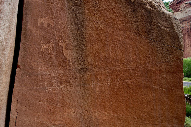 Graffiti messages are seen on a rock panel featuring Native American images at Capitol Reef National Park in Utah. (Capitol Reef National Park/Facebook)