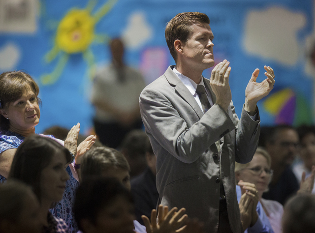 Bob Sweetin applauds an answer from the panel during a public forum to discuss breaking the Clark County School District into 357 individual school precincts at the Fine Arts Building at the Clark ...