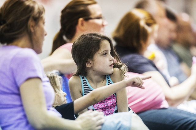 ScotLynn Lewis listens to the panel during a public forum to discuss breaking the Clark County School District into 357 individual school precincts at the Fine Arts Building at the Clark County Fa ...