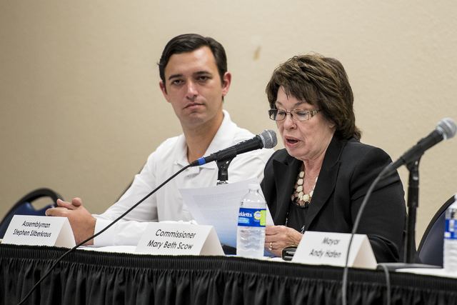 Clark County Commissioner Mary Beth Scow speaks, as Assemblyman Stephen Siberkraus listens during a public forum discussing a plan to reorganize the Clark County School District at Henderson City  ...