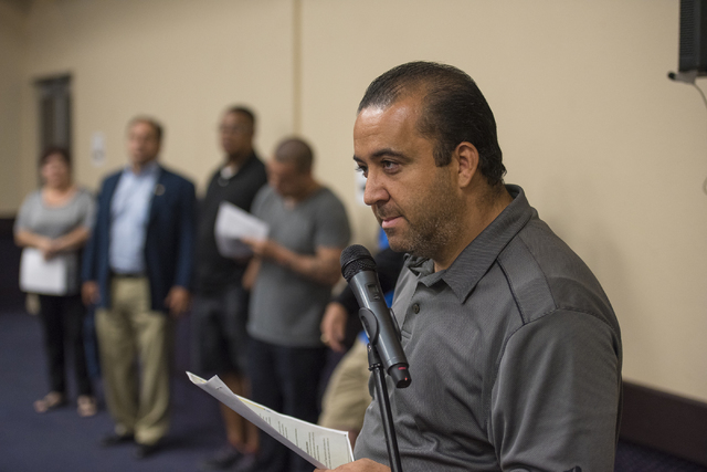Adam Berger, a teacher at Desert Oasis High School, speaks during a public forum discussing a plan to reorganize the Clark County School District at Henderson City Hall on Thursday, July 28, 2016. ...