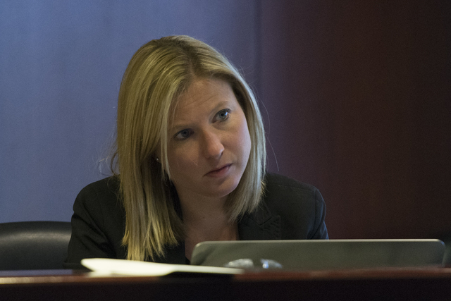 Deputy Legislative Counsel Karly O'Krent listens during a legislative panel meeting to discuss reorganization plans for the Clark County School District at the Sawyer Building in Las Vegas Tuesday ...