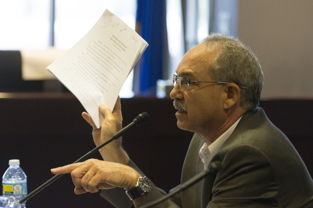 John Vellardita, executive director of the Clark County Education Association, holds up a copy of the draft regulation to reorganize the Clark County School District during a legislative panel mee ...