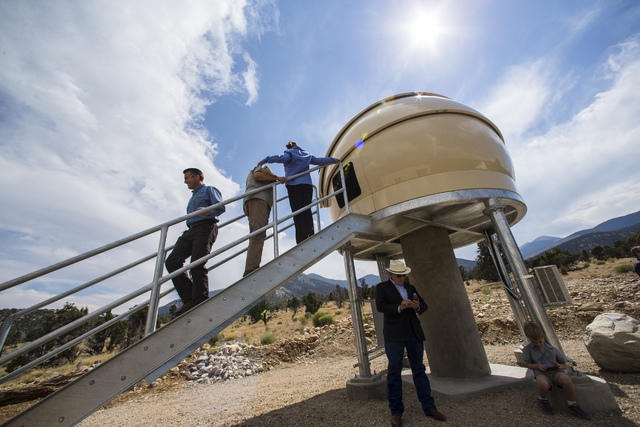Gov. Brian Sandoval, left, walks down stairs after touring the Great Basin Observatory following the first light ceremony for the observatory and National Park Service centennial celebration at Gr ...