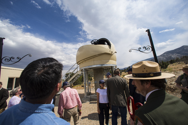 Gov. Brian Sandoval, left and Great Basin National Park Superintendent Steve Mietz watch as the Great Basin Observatory housing opens during first light ceremony for the observatory and National P ...