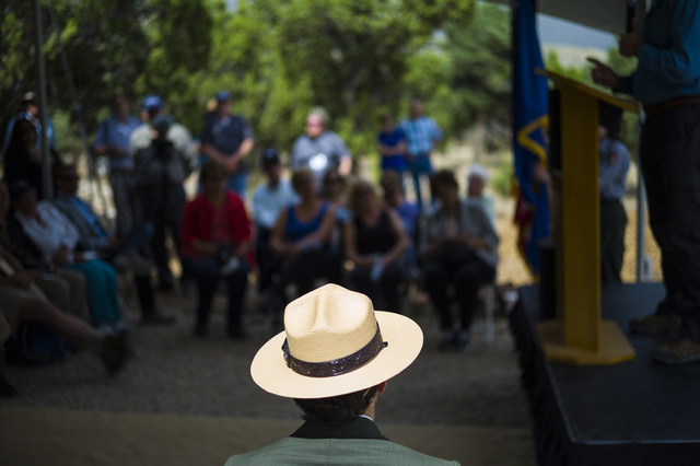 Great Basin National Park Superintendent Steve Mietz listens as Gov. Brian Sandoval speaks during the Great Basin Observatory first light ceremony and National Park Service centennial celebration  ...