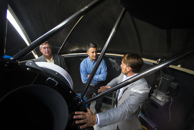 Great Basin Observatory Project Manager Paul Gardner, right, talks with U.S. Rep. Crescent Hardy, R-Nev., left and Gov. Brian Sandoval following the the first light ceremony for the observatory an ...