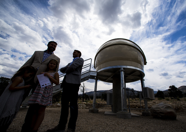 Great Basin Observatory Project Manager Paul Gardner, right, stands with Jason Simison of Sea West Enterprises, which constructed the observatory, before the first light ceremony and National Park ...