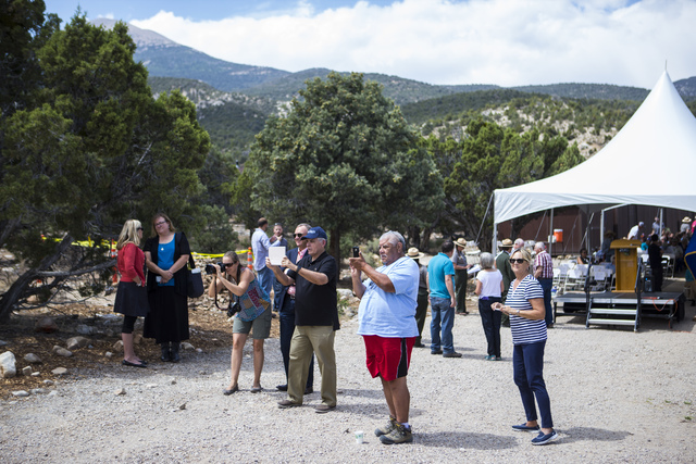 Attendees take photos before the first light ceremony for Great Basin Observatory and National Park Service centennial celebration at Great Basin National Park on Thursday, Aug. 25, 2016. (Chase S ...