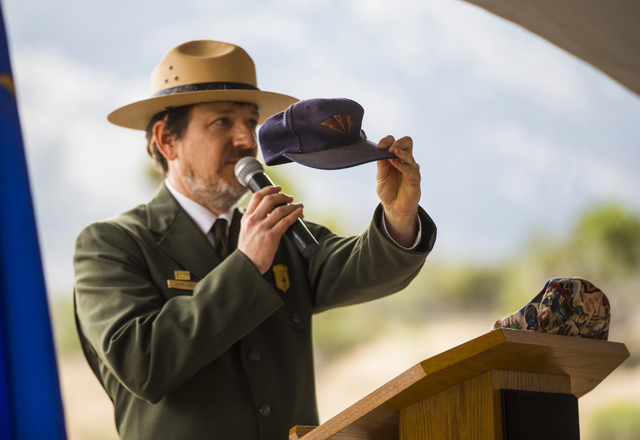 Great Basin National Park Superintendent Steve Mietz holds up a hat which belonged to U.S. Forest Service firefighter Justin Beebe, who died while fighting the Strawberry Fire, during the Great Ba ...