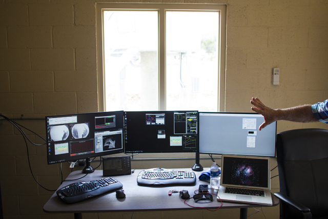 Robert Denny of astronomy software company DC-3 Dreams points to monitors displaying the software at Great Basin Observatory before the first light ceremony for the observatory and National Park S ...