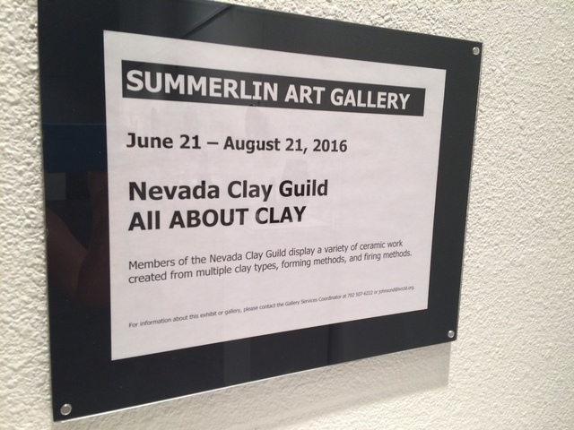 A sign shows the Nevada Clay Guild's exhibit information. Jan Hogan/View