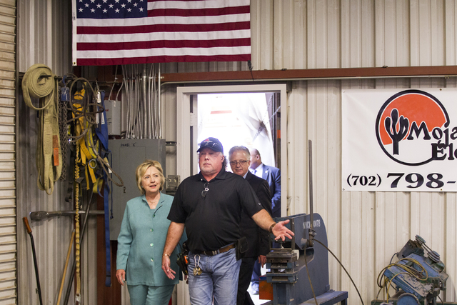 Democratic presidential nominee Hillary Clinton tours Mojave Electric with Mojave Electric supervisor Jackson Renner at Mojave Electric on Thursday, Aug. 4, 2016, in Las Vegas. Erik Verduzco/Las V ...
